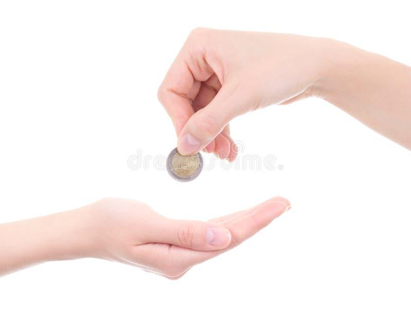 Svuoti moneta femminile della tenuta della mano e della palma l'euro isolata su bianco immagini stock