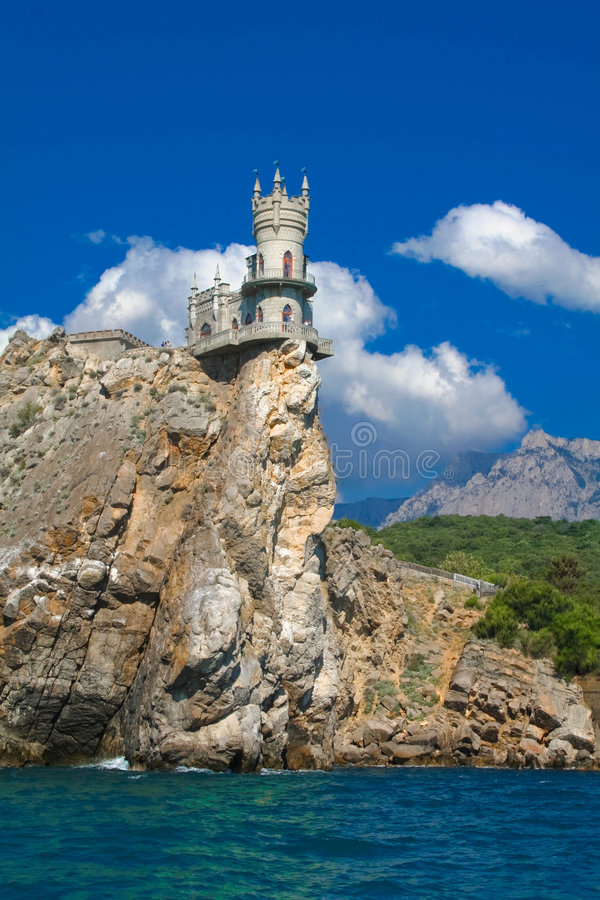 Swallow's Nest. Is a mock-medieval castle near Yalta, in Crimea, Ukraine. It was built between 1911-1912 near Gaspra, on top of 40-meter (130 ft) high Aurora stock images