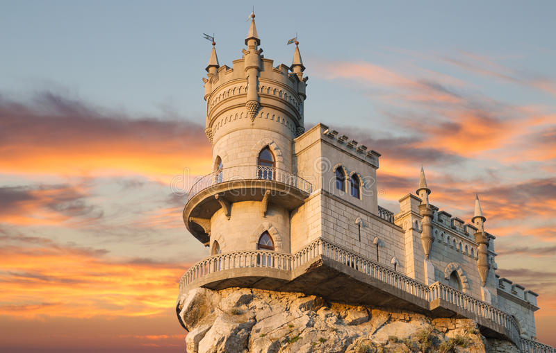 Swallow's Nest castle on the rock over the Black Sea on the sunset royalty free stock images