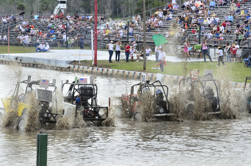 Swamp buggies pull off the starting line stock images