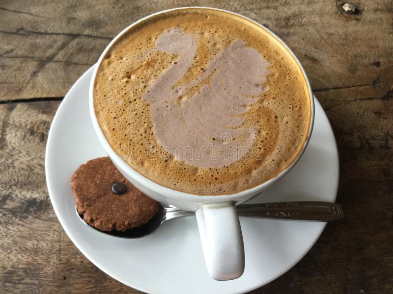 Swan latte. Coffee with cookie. Classic. stock photo