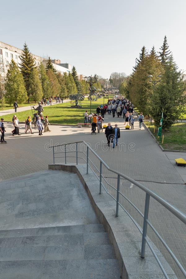 Swan park in Rovno, Ukraine. ROVNO, UKRAINE - APRIL 09, 2018: Unrecognized people walk in the Swan early spring park. Rovno or Rivne is a historic city in stock photography