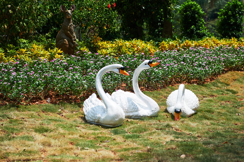 Swan sculpture on meadow stock image