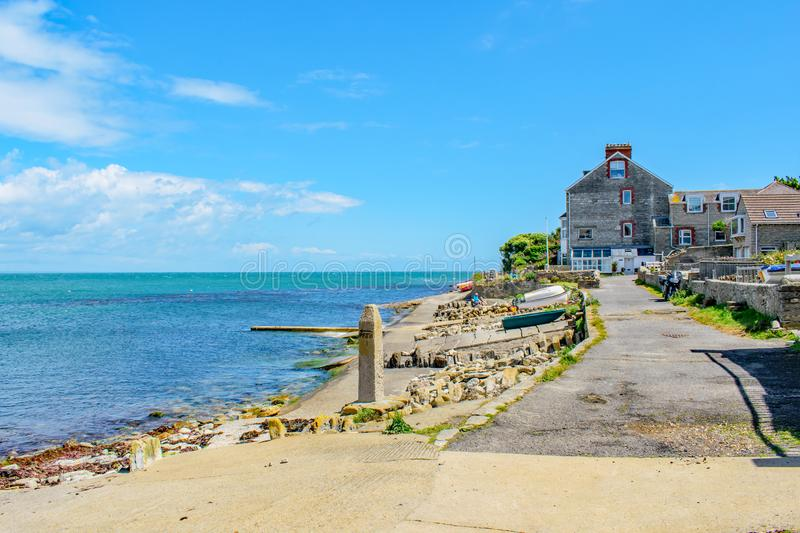 Swanage`s pretty and colourful coastal walk to Peveril Point on a summer day. A view of part of Swanage`s pretty and colourful coastal walk to Peveril Point on a stock photos