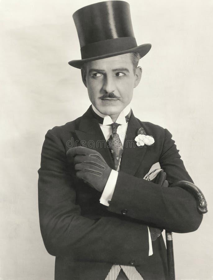 Swanky gentleman in top hat stock images