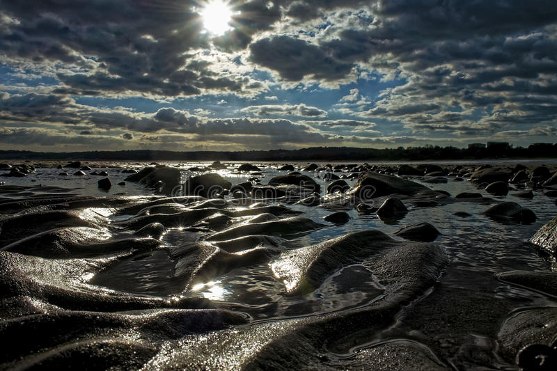 Swansea-Bucht-Sand-Kräuselungen stockbilder