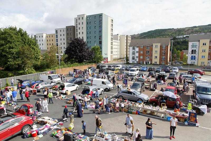 Car Boot Sale in a Car Park. Swansea, UK: August 13, 2017: A car boot sale where local people sell unwanted domestic items or clothes and people buy a secondhand stock photography