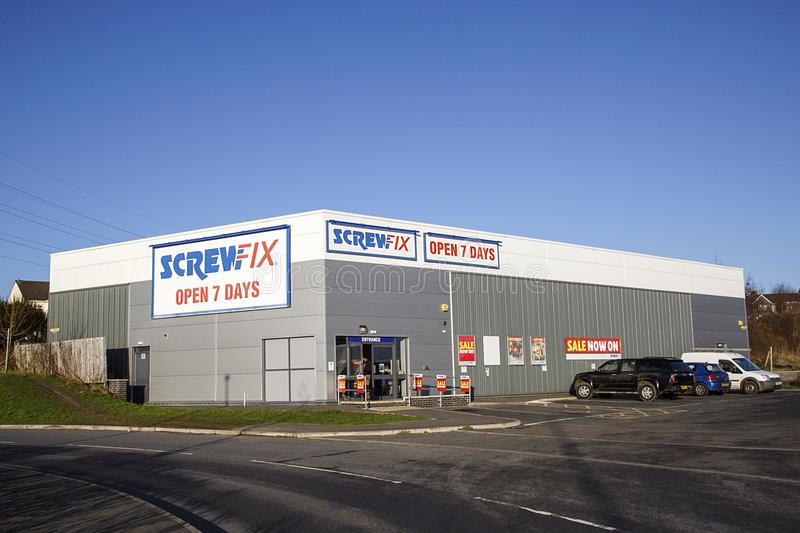 Screwfix shop front with car park and blue sky background. Swansea, UK: December 28, 2016: Customer`s cars parked outside a retail unit. Screwfix is the United stock photo