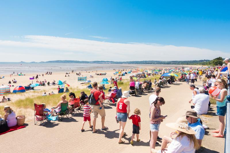 Crowds gather to watch the Welsh Air Show. Swansea, United Kingdom - June 30, 2018: Huge crowds gather on sunny summer day on the public beach in Swansea Bay to stock photo