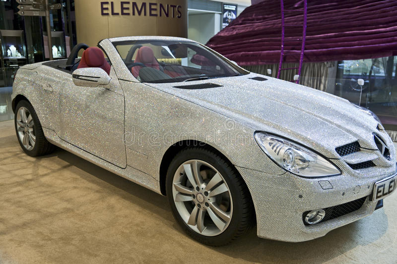Swarovski Mercedes Benz. A Swarovski crystal covered Mercedes Benz inside the Elements Mall in Hong Kong showing off the glittering extravagance royalty free stock images