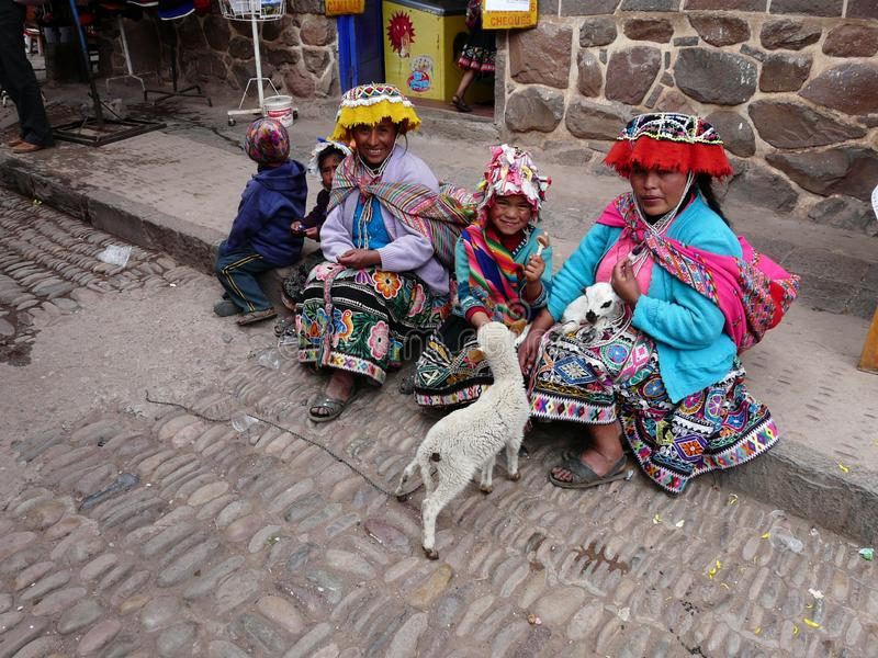 Women in traditional Peruvian clothing in the village of Pisac, Peru royalty free stock image
