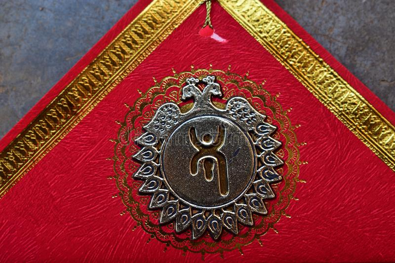 Part of a Bengali New year card. Swastik sign on a red card well come bengali new year or bangla nababarsa stock images