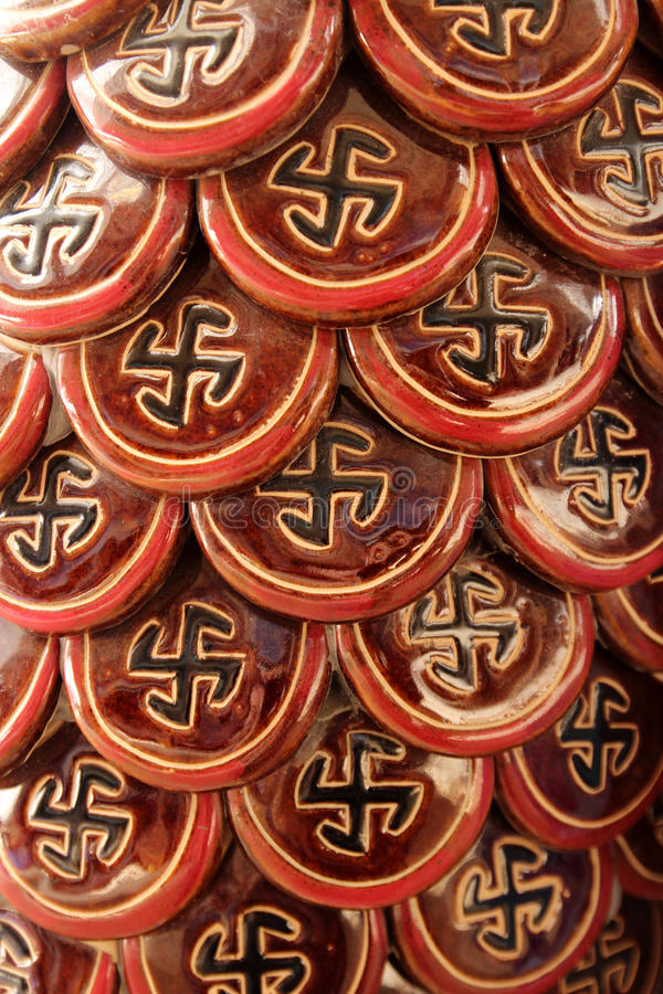 Swastika. Mosaic in the form of a swastika - Hindu symbol of the sun, harmony, unity forces and elements, as well as favorable predestinationon a column in a stock images