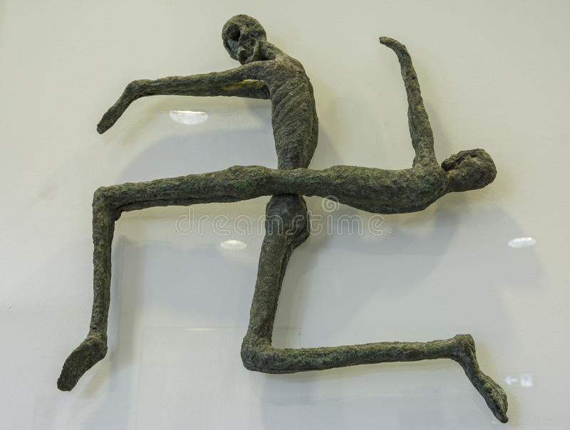 Swastika represented from bronze miniature skeletons stock photography