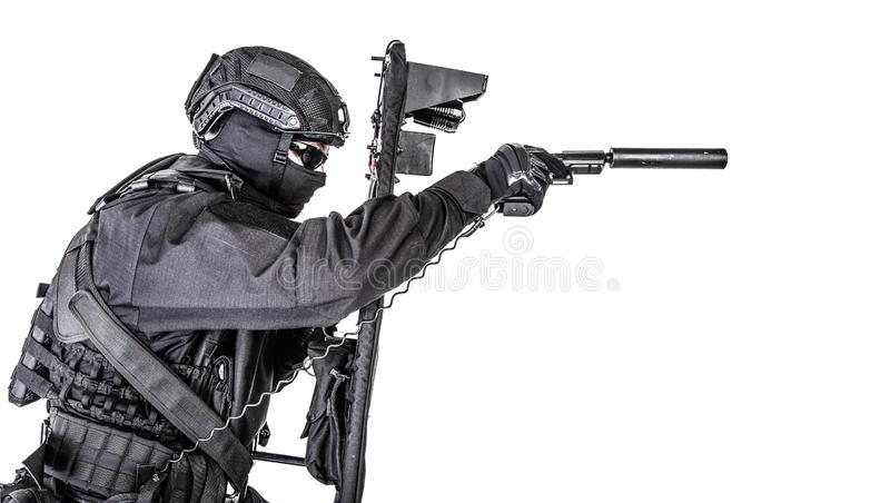 SWAT fighter hiding behind ballistic shield on white. Police special operations and counter-terrorism team, SWAT officer in black uniform, mask and helmet royalty free stock image