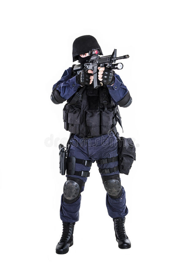 SWAT officer. Special weapons and tactics (SWAT) team officer with his gun royalty free stock image