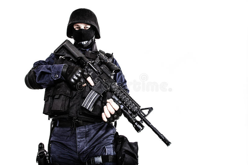 SWAT officer. Special weapons and tactics (SWAT) team officer with his gun stock photos
