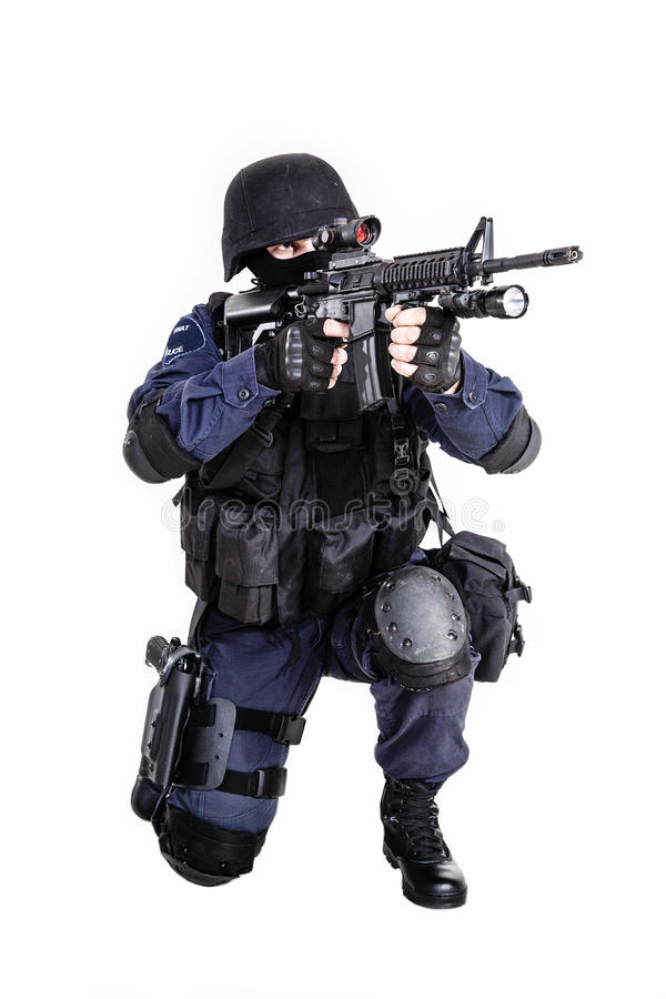 SWAT officer. Special weapons and tactics (SWAT) team officer with his gun stock photo