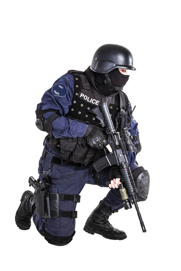 SWAT officer. Special weapons and tactics (SWAT) team officer with his gun royalty free stock images