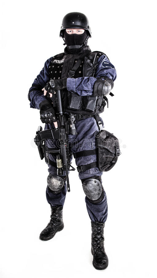 SWAT officer. Special weapons and tactics (SWAT) team officer with his gun stock images