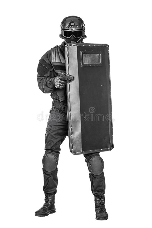SWAT officer with ballistic shield. Spec ops police officer SWAT with ballistic shield studio shot stock photos