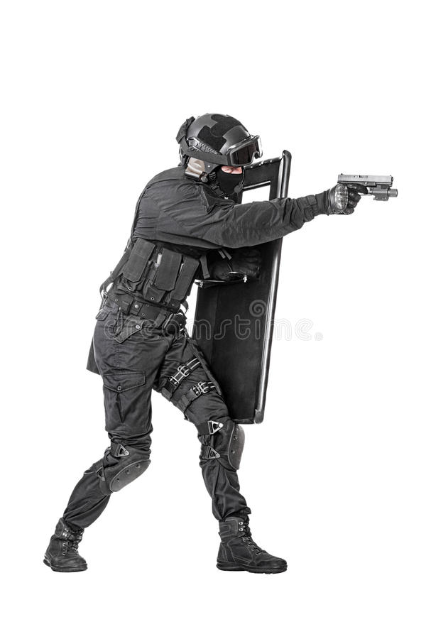 SWAT officer with ballistic shield. Spec ops police officer SWAT with ballistic shield studio shot stock photography