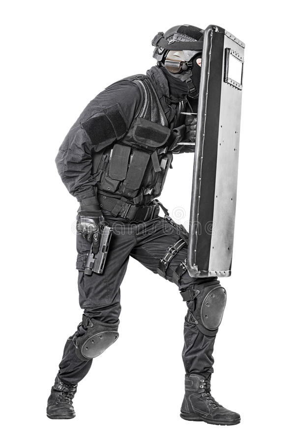 SWAT officer with ballistic shield. Spec ops police officer SWAT with ballistic shield studio shot royalty free stock image