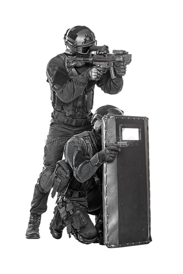 SWAT officers with ballistic shield. Spec ops police officer SWAT with ballistic shield studio shot royalty free stock images