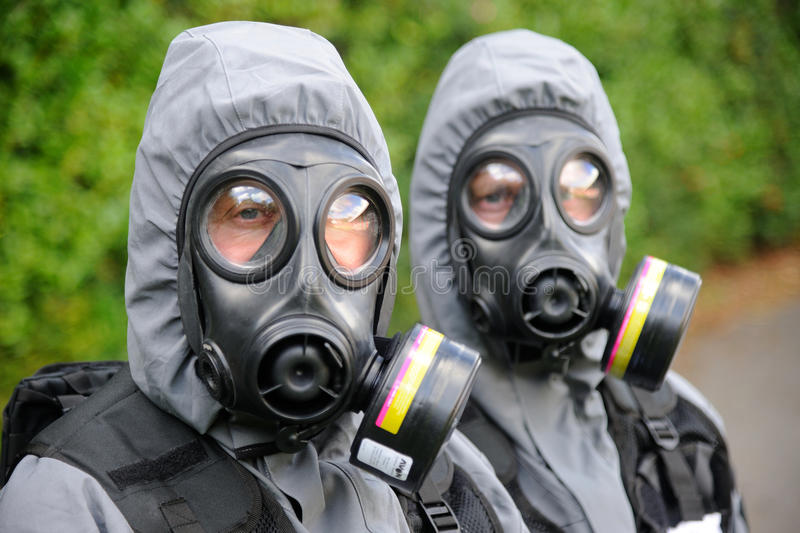 SWAT officers in gas masks stock images