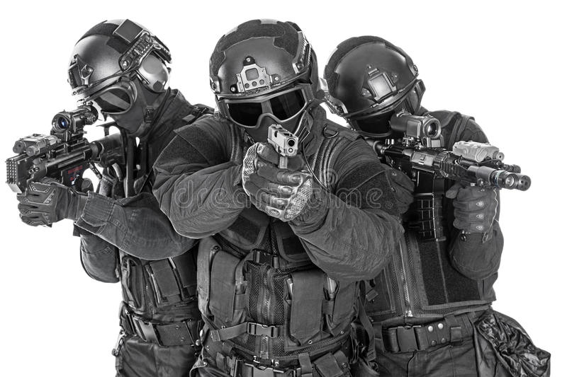 SWAT officers. Spec ops police officers SWAT in black uniform and face mask studio shot royalty free stock images
