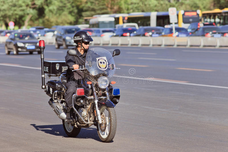 SWAT Police officer on a motorbike, Beijing, China royalty free stock photo