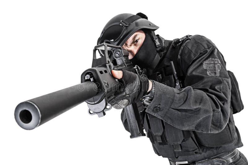 SWAT police officer. Spec ops police officer SWAT in black uniform studio shot stock photography