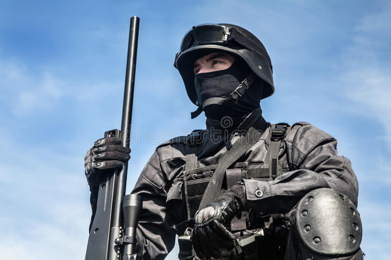 SWAT police sniper. In black uniform in action royalty free stock image