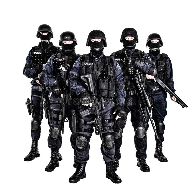 SWAT team. Special weapons and tactics (SWAT) team officers with guns royalty free stock image