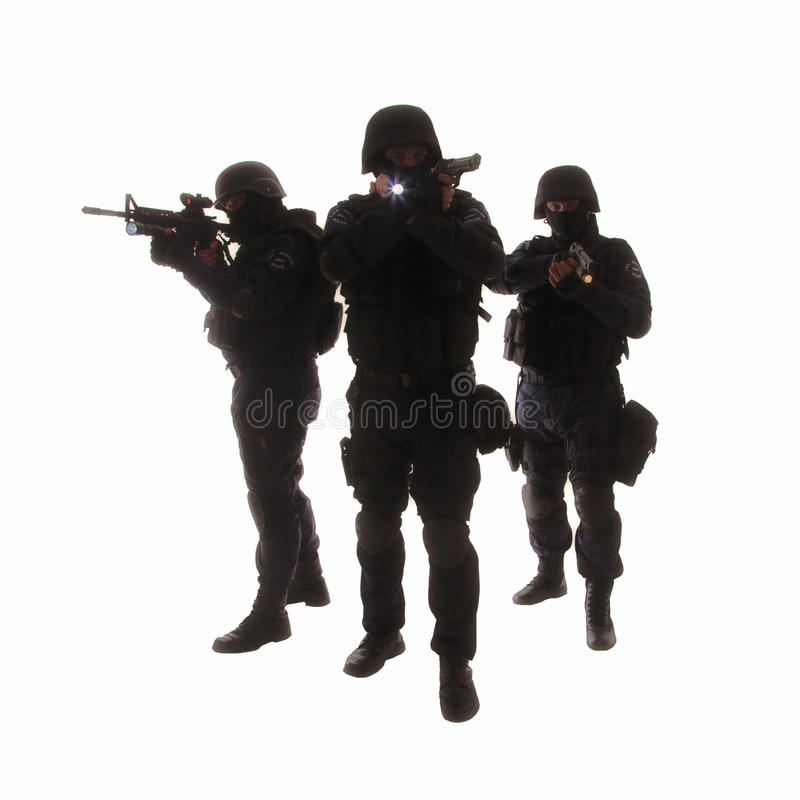 SWAT team. Silhouettes of special weapons and tactics (SWAT) team in action stock photo