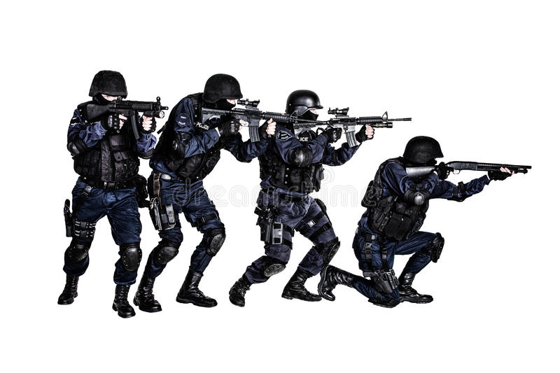 SWAT team in action. Special weapons and tactics (SWAT) team in action stock image