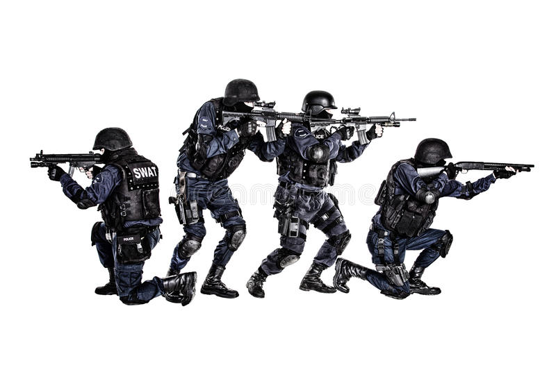 SWAT team in action. Special weapons and tactics (SWAT) team in action royalty free stock photography