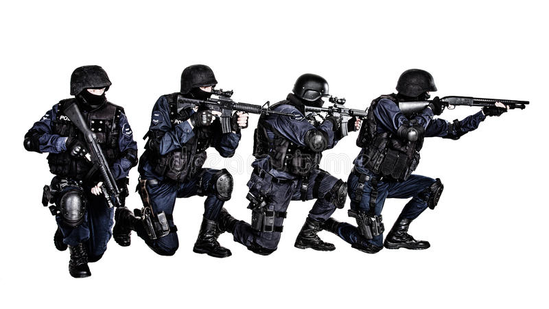 SWAT team in action. Special weapons and tactics (SWAT) team in action royalty free stock photo