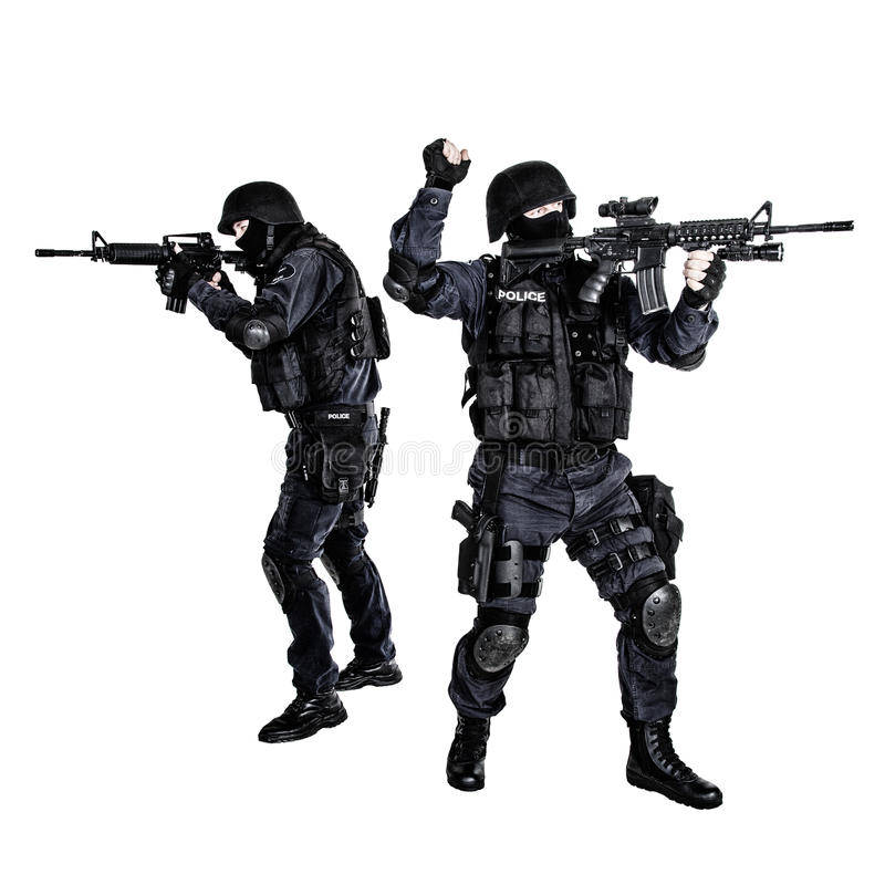 SWAT team in action. Special weapons and tactics team in action royalty free stock images