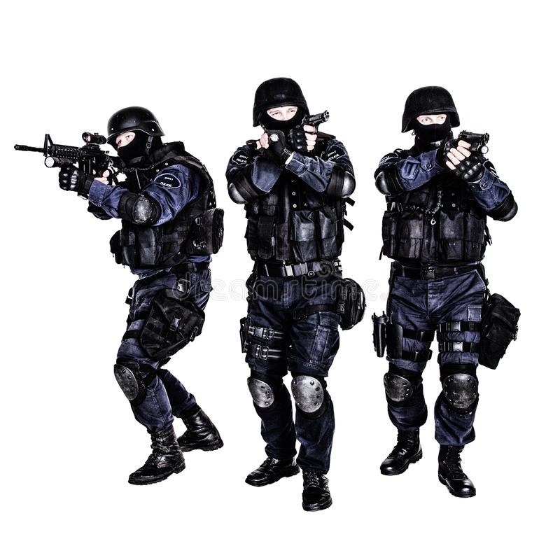 SWAT team in action. Special weapons and tactics (SWAT) team in action royalty free stock image