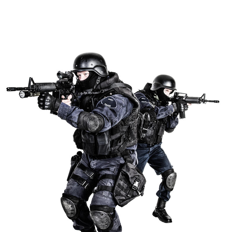 SWAT team in action. Special weapons and tactics (SWAT) team in action stock photo