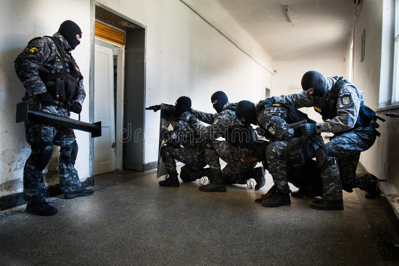 SWAT team. Special forces intervention. Romanian Police SWAT team in action. The team has 5 members all focused and ready for the ambush. Their lives depend on