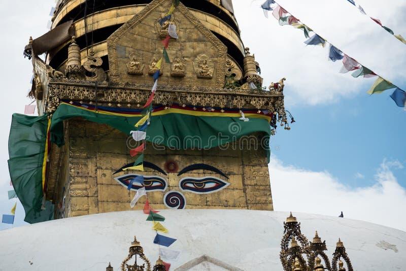 Swayambhunath stupa Eye Buddha Kathmandu. Swayambhunath is an ancient religious architecture atop a hill in the Kathmandu Valley, west of Kathmandu city. The royalty free stock image