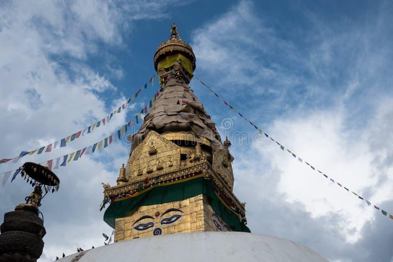 Swayambhunath stupa Eye Buddha Kathmandu. Swayambhunath is an ancient religious architecture atop a hill in the Kathmandu Valley, west of Kathmandu city. The stock images