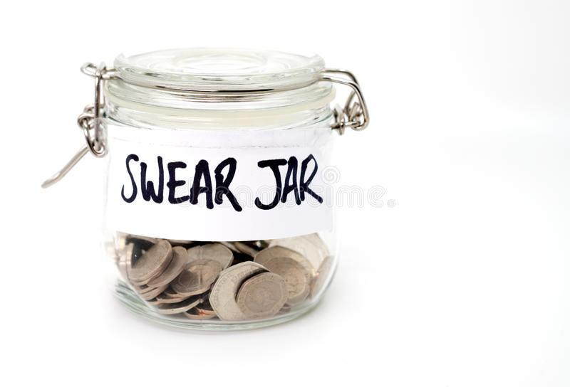 Swear jar with coins. On a white background royalty free stock photos