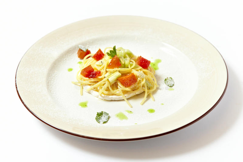 Sweat pasta nests with fruits royalty free stock image
