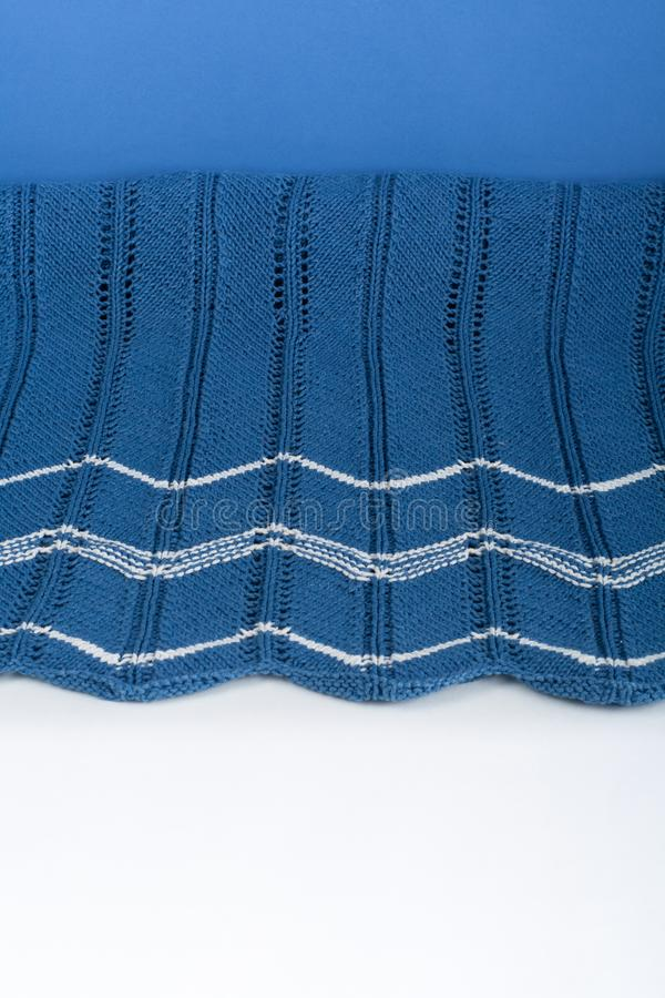 Sweater or scarf fabric texture large knitting. Knitted jersey background with a relief pattern. Braids in knitting stock photography