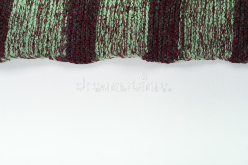 Sweater or scarf fabric texture large knitting. Knitted jersey background with a relief pattern. Wool hand- machine stock images