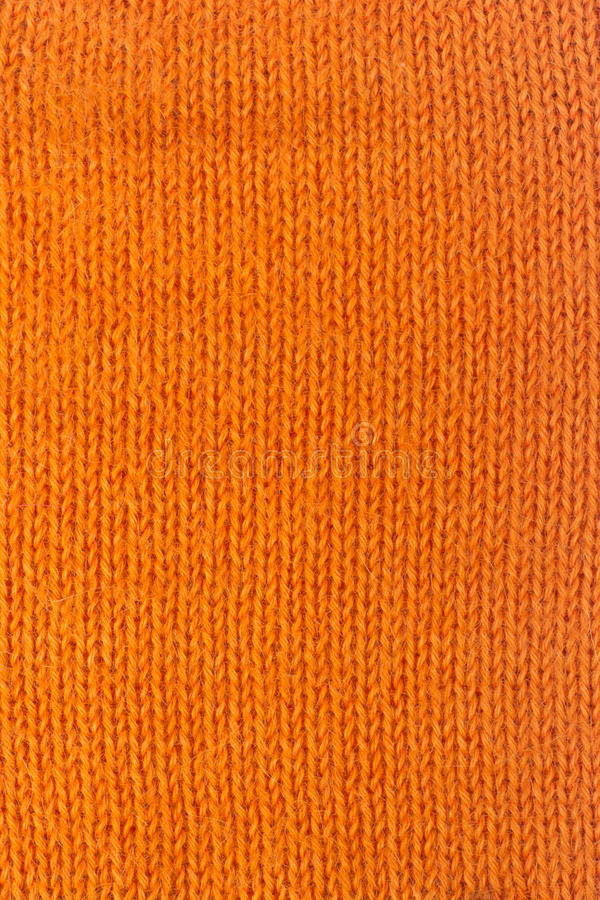 Sweater or scarf fabric texture large knitting. Knitted jersey background with a relief pattern. Wool hand- machine stock photos