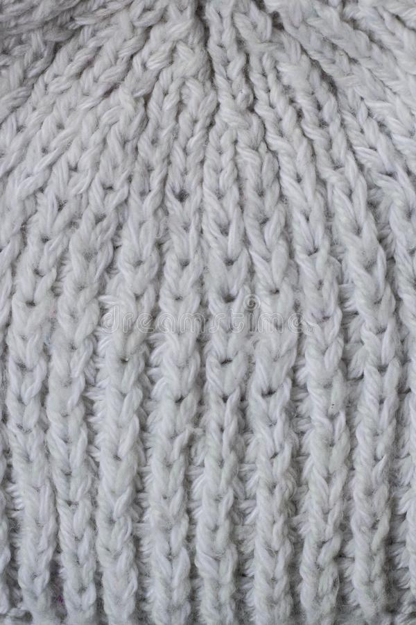 Sweater or scarf Pattern Of White Knitted Fabric Texture Background stock image